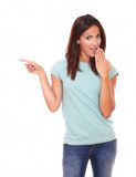 Surpriesed adult lady pointing to her right Royalty Free Stock Photos