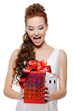 Surpris female holding the christmas present Stock Images
