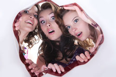 Surprise. Young women look into the shopping bag surprisingly royalty free stock images