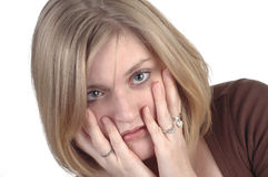 Surprise. A woman with her hands on her cheeks in surprise royalty free stock image