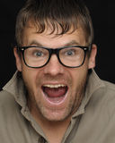 Surprise. Caucasian man with glasses and look of surprise on black background royalty free stock image