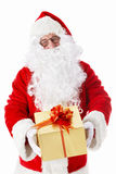 Surprise. Santa Claus handed a gift on a white background Royalty Free Stock Images