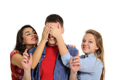Surprise!. Happy girls covering man's eyes wanting to surprise him Royalty Free Stock Photos