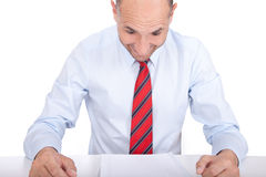 Surprise. A business man reading a report and being surprise by its content Royalty Free Stock Photo