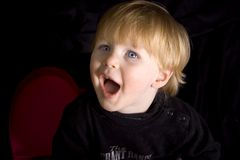 Surprise!. Child with Surprised look on face, dramatic lighting stock photo