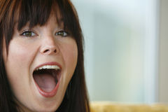 Surprise!. A look of open mouthed surprise on a young woman's face Stock Photography