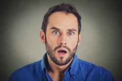 Surprise astonished man. Closeup portrait man looking surprised in full disbelief Royalty Free Stock Images