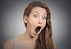 Surprise astonished woman. Closeup portrait woman looking surprised in full disbelief  wide open mouth isolated grey wall background. Positive human emotion Royalty Free Stock Image
