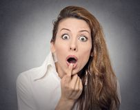 Surprise astonished woman. Closeup portrait woman looking surprised in full disbelief wide open mouth isolated grey wall background. Positive human emotion Royalty Free Stock Photography
