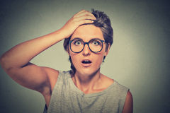 Surprise astonished woman with glasses looking in full disbelief Royalty Free Stock Image