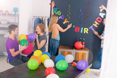 Surprise birthday party. Bunch of friends preparing decorations for surprise birthday party Stock Images