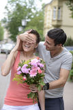 Surprise with bouquet of flowers Stock Photo