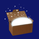 Surprise box or delivery with stars and copyspace, over blue - c Royalty Free Stock Photos