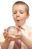 Surprise of the boy. Which holds a round magic sphere in hands Stock Images