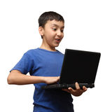 Surprise boy with laptop Stock Image