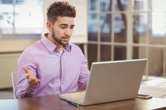 Surprise businessman looking at laptop Stock Image