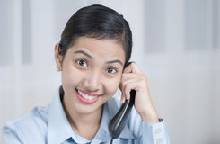 Surprise Call. Happy asian lady receiving surprise telephone call Stock Image