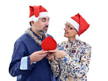 Surprise Christmas gift adult couple Royalty Free Stock Images