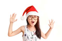 Surprise in Christmas. Lovely asian girl wear Christmas red hat with surprise  emotion Royalty Free Stock Photo