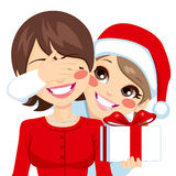 Surprise Christmas Present Daughter Mom. Little daughter smiling covering her happy mother eyes on Christmas day hiding surprise present stock illustration