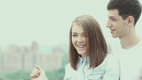 Surprise with closed eyes. Romantic man gave his girlfriend a surprise. Couple in love. The girl closed her eyes with their hands. Surprise for lover stock video footage