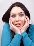 Surprise concept - amazed cute woman stock photo