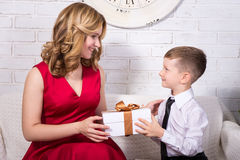 Surprise concept - little boy giving present to mother Royalty Free Stock Photography