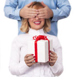 Surprise concept. Man giving present to his wife Royalty Free Stock Image