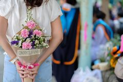 Surprise for congratulation. Woman hide bouquet for surprise someone royalty free stock photography