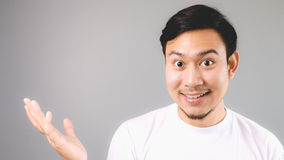 A surprise content for you. An asian man with white t-shirt and grey background royalty free stock images