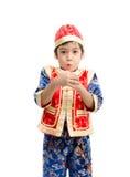 Surprise de petit garçon avec le présent pendant la nouvelle année chinoise image libre de droits