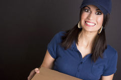 Surprise Delivery Woman in Uniform Brings Packages Royalty Free Stock Image