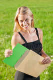 Surprise envelope young businesswoman sunny meadow Stock Photo