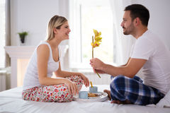 Surprise flower for woman in bed Royalty Free Stock Photo