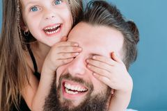 Surprise fun laugh family leisure girl cover eyes. Surprise enjoyment fun laughter and happy family leisure. parenting happiness and delight. little girl stock images