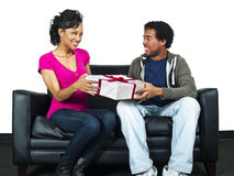 Surprise gift. Male about to surprise his girlfriend with a gift Royalty Free Stock Image
