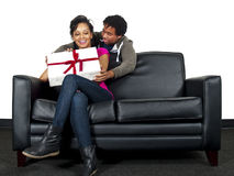 Surprise gift. Male about to surprise his girlfriend with a gift Stock Photo