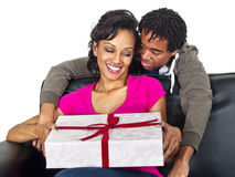 Surprise gift. Male about to surprise his girlfriend with a gift Stock Photography