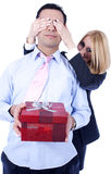 Surprise with gift box. A woman is making a surprise to her partner with a red gift box Stock Photo