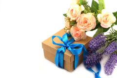 Surprise gift box with blue summer with a bouquet of roses stock images