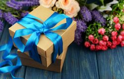 Surprise gift box with blue summer with a bouquet of roses stock image