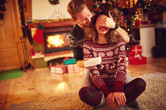 Surprise with gift. Christmas surprise with gift, love couple stock photos