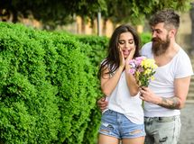 Surprise for her. Man gives flower bouquet girl romantic date. Couple meeting date park background. Guy prepared. Surprise flowers for girlfriend. Bouquet stock photos