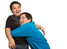 Surprise hug. Between two brothers Stock Image