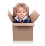 Surprise inside the box. Little boy playing jack in the box with a cardboard box royalty free stock images