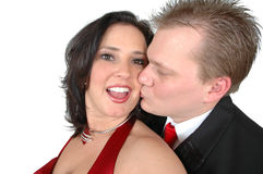 Surprise Kiss. Man sneaks up behind woman to give her a kiss on the cheek stock images