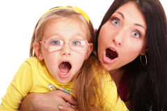 Surprise litle baby toddler girl playing mom. Happy family Mom end daughter to be speechless with surprise isolated young screaming woman Royalty Free Stock Images