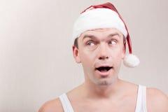 Surprise man in santa hat Royalty Free Stock Images