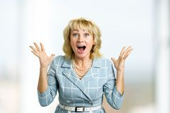 Surprise mature woman with good news. Royalty Free Stock Images