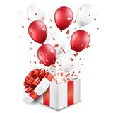 Surprise open gift box with balloons and confetti Stock Images
